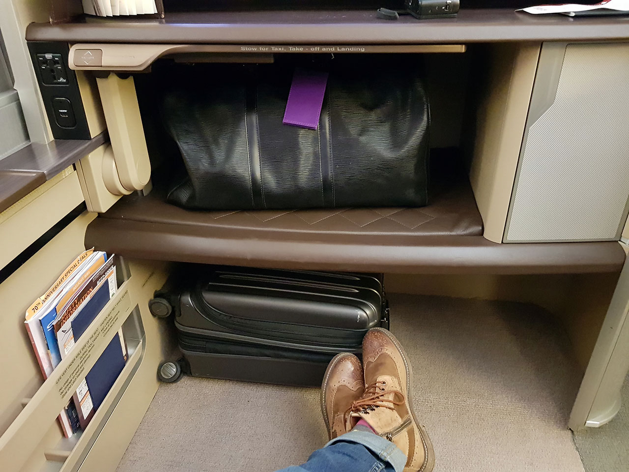 Singapore Airlines 777-300ER First Class storage space