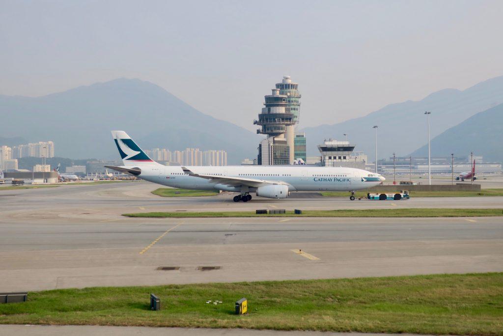 Cathay Pacific plane on tarmac at Hong Kong International Airport
