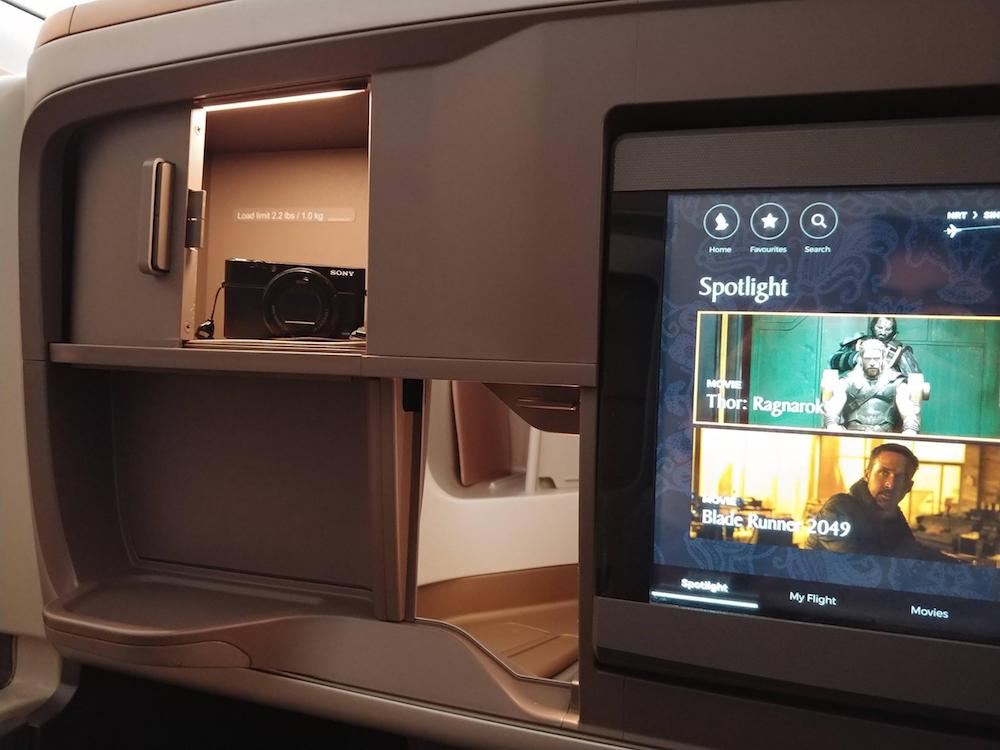 Singapore Airlines 777-300ER small compartment and inflight entertainment screen