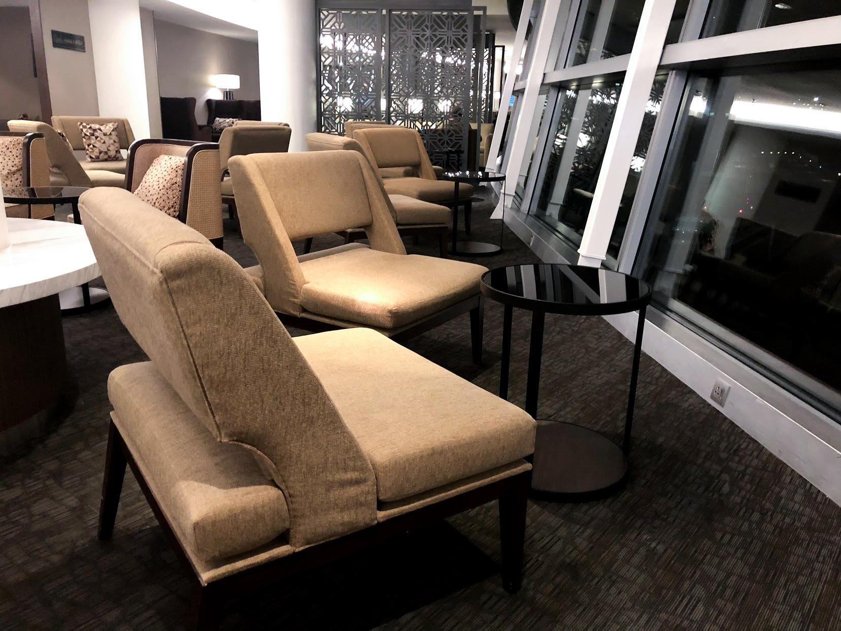 Malaysia Airlines Domestic Golden Lounge Kuala Lumpur seating area with tarmac view