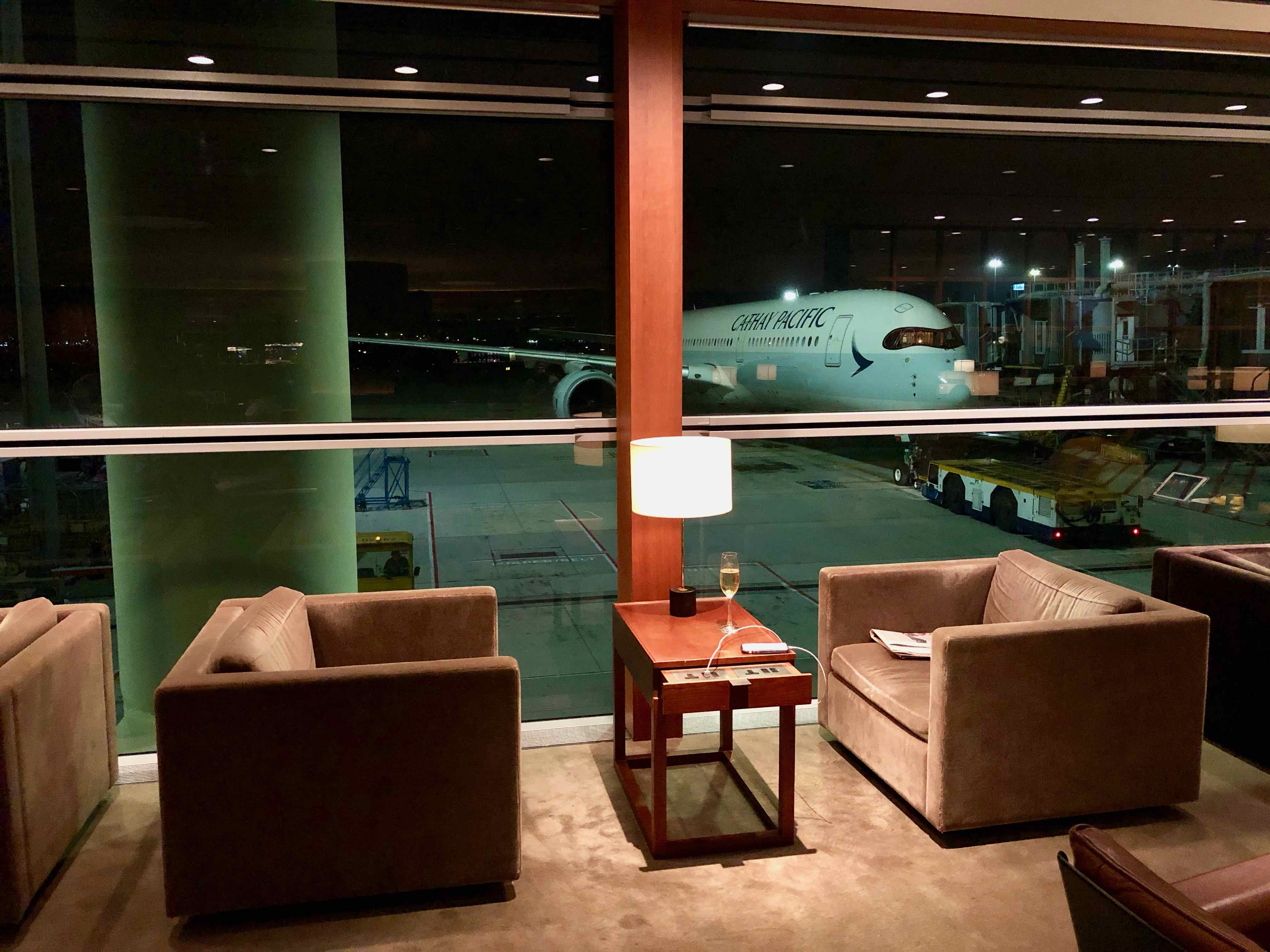 Cathay Pacific The Pier Business Class Lounge Hong Kong seating option by the window