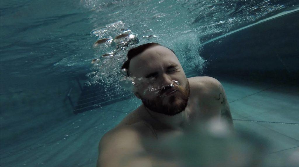 Bradley John swimming at W Hotel Singapore