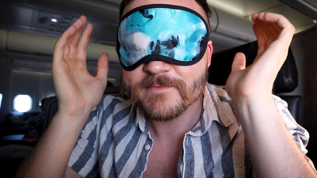 Bradley John wears Eye Mask on Qantas Business Class